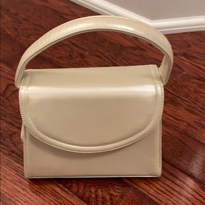 Cream bag with snap closure. excellent condition